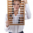 Girl holds in front of abacus — Stock Photo #31273067