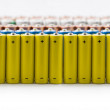 Isolated batteries in a row — Stock Photo