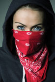 Girl hood and red scarf covered face — Stock Photo