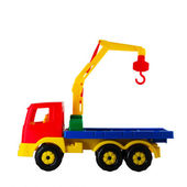 Hoisting crane toy on a white isolated — Stock Photo