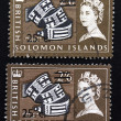 Two British Solomon Islands stamps - Stock Photo