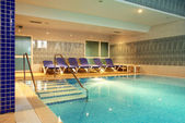Blue indoor swimming pool — Stock Photo