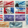 Old American stamps on album page - Stock Photo