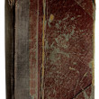 Stock Photo: Tattered antique book isolated