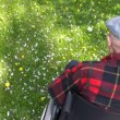 Old man in wheelchair enjoying spring in the park — Stock Video