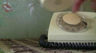 Woman hand dialing an old white telephone — Stock Video