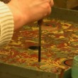 Stock Video: Learners of ebru art practicing