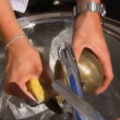 A man washing vintage brass pitcher — Stock Video #32622083