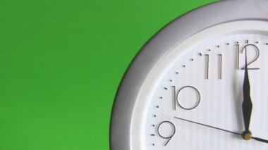 Electric clock isolated on green, last seconds to 12 — Stock Video