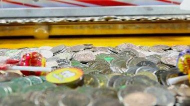 Coin push machine in amusement park — Stock Video