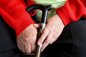 Old womans hands with cane — Foto de Stock