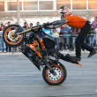 Постер, плакат: Motorcyclist performing extreme stand