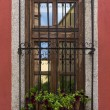 Old window on red wall — Stock Photo