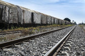Old rusty train wagons on railway — Stock Photo