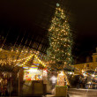 Royalty-Free Stock Photo: Christmas market around fir tree in the Old Town of Tallinn, Estonia