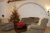 Living room and shiny lighted christmas tree — Stock Photo
