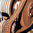 Stock Photo: Rusty chain transmission consist of one big and small cogwheel and large strong chain
