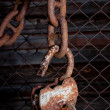 Old padlock hanging on a chain — Foto Stock