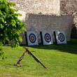 Royalty-Free Stock Photo: Crossbow and targets in front of limestone wall