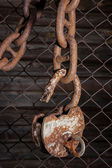 Old padlock hanging on a chain — Stock Photo