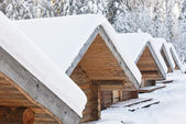 Small camping houses at snowy winter day — Stock Photo