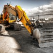 Stock Photo: Mighty yellow excavator