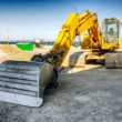 Mighty yellow excavator — Stock Photo