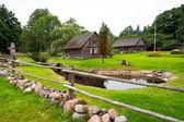 Farm house and green garden — Stock Photo