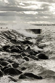 Pier in turbulent and stormy sea — Stock Photo