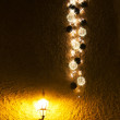 Illuminated Christmas decorations on wall - Stock Photo