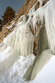 Tall icicles on a cliff — Stock Photo