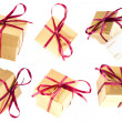Set of golden isolated gift boxes — Stock Photo #24628579