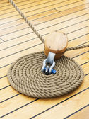 Rope in a spiral shae on ship floor — Stock Photo