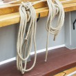 Ropes hang in a wooden sail ship — Stock Photo