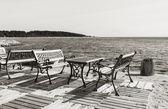 Seats and table near sea — Stock Photo