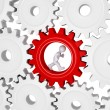 Worker running inside of one cogwheel out of many — Stock Photo #27529177