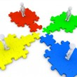 Special puzzle piece joins four people — Stok fotoğraf