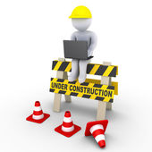 Under construction sign and a worker with laptop — Stock Photo