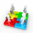 Four businessmen are united by puzzle pieces — Stock Photo #51463891