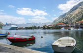 View on the port of kotor with cruise ship and boats — Stock Photo
