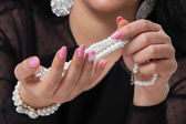 Pearls and Nails — Stock Photo