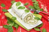 Spinach roll with cheese and ham — Stock Photo