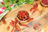 Chili peppers and herbs — Stock Photo