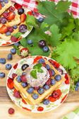 Waffles with fresh fruits  and cream — Stock Photo