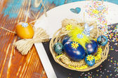 Easter eggs on vintage blackboard — Stock Photo