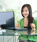 Beautiful young student have good news on the computer screen — Stock Photo