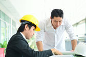 Two engineers are planning serious — Stock Photo