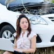 Business Woman and car breakdown looking for mechanic - Stock Photo