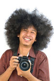 Smiling young man with long hair — Stock Photo