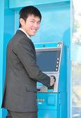 Business man using Automatic Telling Machine — Stock Photo